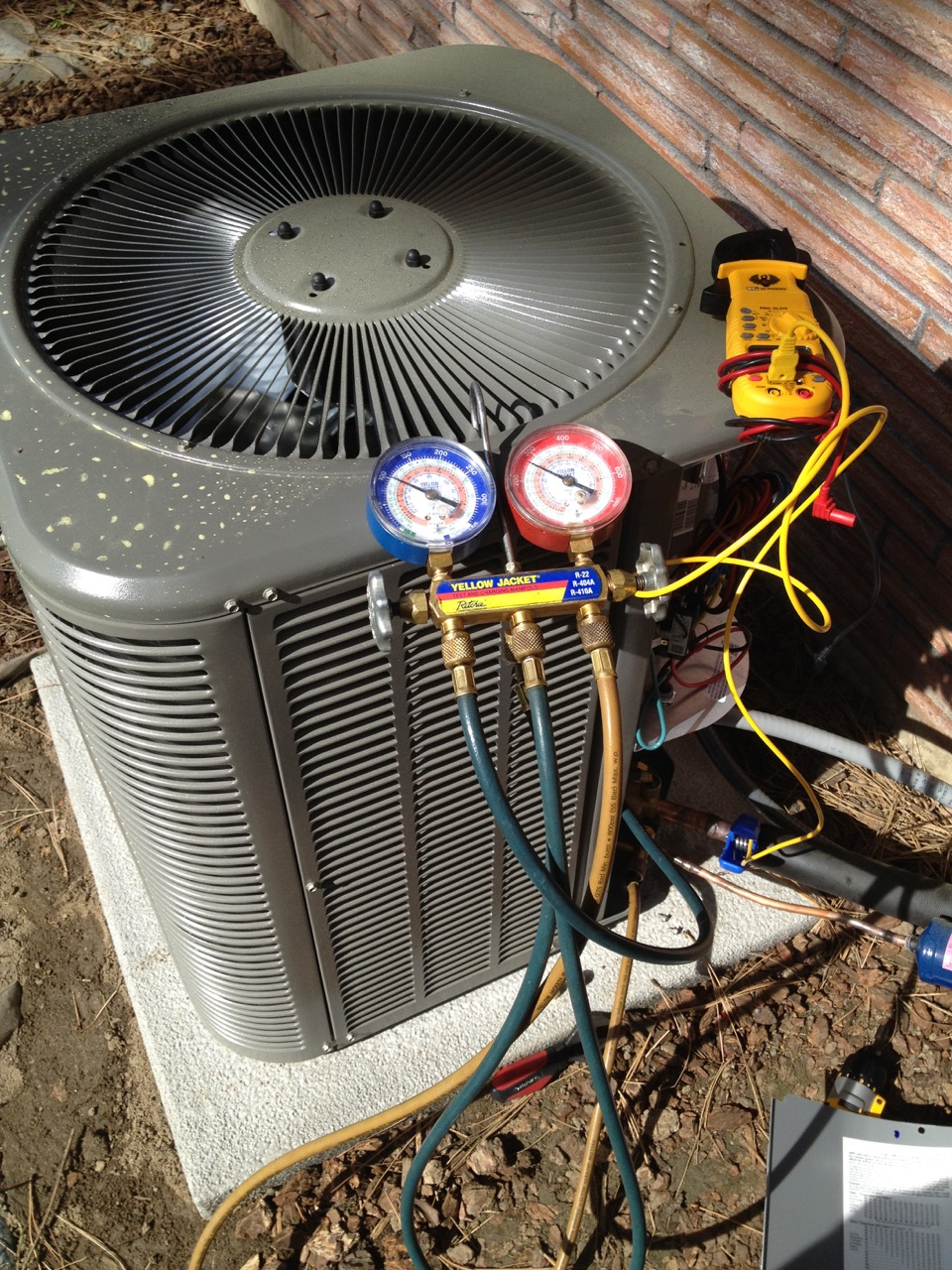 air-conditioner-being-serviced-by-revive-heating-and-air-conditioner